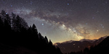 On a Starry Night the Milky Way Shows its Magnificent Beauty over Snow-Covered Austrian Alps Photographic Print by Babak Tafreshi