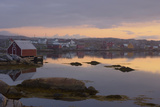 Fishing Village Along the Water's Edge at Sunset; Fogo Island, Newfoundland, Canada Photographic Print by  Design Pics Inc