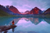 Couple Sitting on Rock Enjoying Scenery at Turquoise Lake and Telaquana Mtn Lake Clark Nat Park Ak Photographic Print by  Design Pics Inc