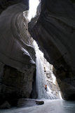 Female Climber Explores Ice Climbing in the Narrows of Maligne Canyon in Jasper National Park Photographic Print by  Design Pics Inc