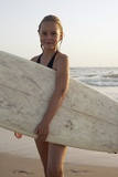 Young Girl with Surfboard Photographic Print by  Design Pics Inc