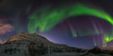 View of the Aurora Borealis, Northern Lights, in Northern Norway Fotografisk tryk af Babak Tafreshi