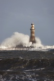 Waves Crashing Against a Lighthouse; Sunderland, Tyne and Wear, England Photographic Print by  Design Pics Inc