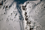 Person Snowboarding Down Chute at Eaglecrest Ski Resort Douglas Isl Near Juneau Alaska Se Winter Photographic Print by  Design Pics Inc