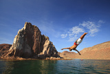 A Man Dives into the Water Off Espiritu Santos Island Near La Paz; Baja California Mexico Photographic Print by  Design Pics Inc