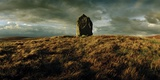 A Neolithic Standing Stone Upon a Knoll Photographic Print by Macduff Everton