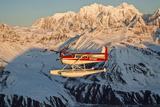 View of a Cessna 185 Floatplane in Alaska Range over Ruth Glacier at Sunset, Southcentral Alaska Fotografisk tryk af Design Pics Inc