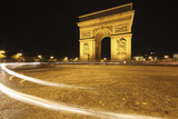 Traffic Light Trails around the Arc De Triomphe; Paris France Photographic Print by  Design Pics Inc