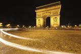 Traffic Light Trails around the Arc De Triomphe; Paris France Photographic Print by  Design Pics Inc