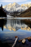 Maroon Bells in Winter Reflected in Maroon Lake Photographic Print by Keith Ladzinski