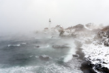 Sea Smoke Rises Up around Maine's Portland Head Light on a Cold Winter's Day Photographic Print by Robbie George