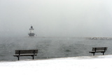 The Portland Breakwater Light Lighthouse Is Just Visible on a Snowy Winter's Day Photographic Print by Robbie George