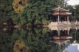 People Resting under Pagoda on Hoan Kiem Lake Shore Photographic Print by  Design Pics Inc