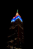 The Empire State Building Is Colorfully Lit Up on a December Night Photographic Print by Robbie George