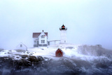 Maine's Nubble Lighthouse Shines on a Cold Winter's Day Stampa fotografica di Robbie George