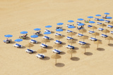 Beach Chairs and Umbrellas Set Up in Row on the Beach; Albufeira Algarve Portugal Photographic Print by  Design Pics Inc