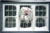 A Window at Maine's Nubble Lighthouse Is Festively Decorated for Winter Stampa fotografica di Robbie George