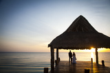 Newlyweds Watch the Sunset after their Beach Wedding on the West Coast of Cozumel Island Photographic Print by Michael Lewis