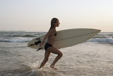 Young Girl with Surfboard; Costa De La Luz,Andalusia,Spain Papier Photo par  Design Pics Inc