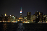 The New York City Skyline, Featuring the Colorful Empire State Building, on a December Night Photographic Print by Robbie George