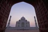 The Taj Mahal at Dusk as Seen Through Arch Photographic Print by  Design Pics Inc