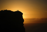 Sunset at the Cliffs of Moher on the West Coast of Ireland Photographic Print by Chris Hill
