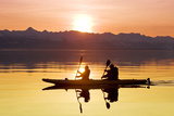 Kayakers Paddle the Calm Waters of Alaska's Lynn Canal at Sunset with the Chilkat Mountains Photographic Print by  Design Pics Inc