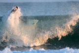 A Surfer Rides a Winter Wave Off the Coast of Maine Photographic Print by Robbie George