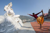 Young Boys Practice Yoga Along the Ganges River in Rishikesh, India Photographic Print by Pete McBride