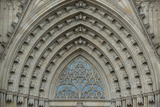 A Detail of the Arch Work and Tracery Above the Main Entrance of the Catedral De Barcelona Photographic Print by Michael Melford