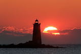 The Sun Rises Behind Whaleback Light Offshore from Kittery, Maine Photographic Print by Robbie George