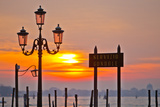 Sunrise over the Gondola Station at Saint Mark's Square in Venice Photographic Print by Mike Theiss