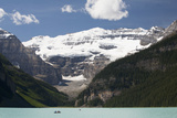 Mount Victoria and Lake Louise with Canoes Photographic Print by  Design Pics Inc