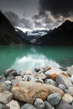 A Pile of Smooth Rocks on the Shore of Lake Louise in Banff National Park Photographic Print by Keith Ladzinski