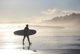 A Winter Surfer Walks Along Higgins Beach in Maine Photographic Print by Robbie George