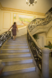 A Tourist Ascends the Staircase at the Hotel San Miguel in Havana Vieja Photographic Print by Michael Lewis