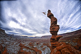 Two People Base Jump from Ancient Art at Fisher Towers Photographic Print by Keith Ladzinski
