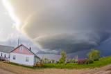 A Rotating Mesocyclone Supercell Thunderstorm Filling the Sky over a Small Church Photographic Print by Mike Theiss
