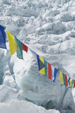 Prayer Flags over Look Climbers Scaling the Khumbu Icefall Photographic Print by Pete McBride