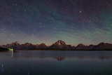 The Night Sky over Jackson Lake Dam Photographic Print by Babak Tafreshi