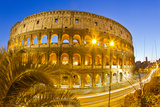 The Ancient Roman Colosseum Casts an Illuminated Golden Light at Dusk Photographic Print by Mike Theiss