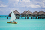 Tourists Sailing Past Bungalows on Stilts over Water in the Pacific Photographic Print by Mike Theiss