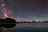 The Bright Summer Milky Way Appears over the Jackson Lake Dam Photographic Print by Babak Tafreshi