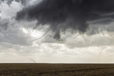 A Long, Snake-Like, Tornado Spins across Cropland Photographic Print by Jim Reed
