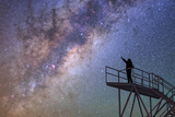 A Stargazer Points at the Constellations Scorpius and Sagittarius at the Cerro Paranal Observatory Photographic Print by Babak Tafreshi