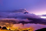 The Tungurahua Volcano Erupting at Night, Endangering the City of Banos Photographic Print by Mike Theiss