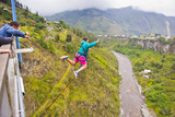 Tourists Bungee Jumping Off the San Francisco Bridge in Banos, Ecuador Photographic Print by Mike Theiss