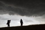 A Television Media Crew Documents a Severe Thunderstorm Photographic Print by Jim Reed