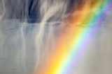 A Thunderstorm Produces a Curtain of Falling Hailstones Next to a Rainbow Photographic Print by Jim Reed