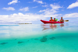A Father and His Sons Kayaking in the Turquoise Waters Off the Coast of Moorea Photographic Print by Mike Theiss